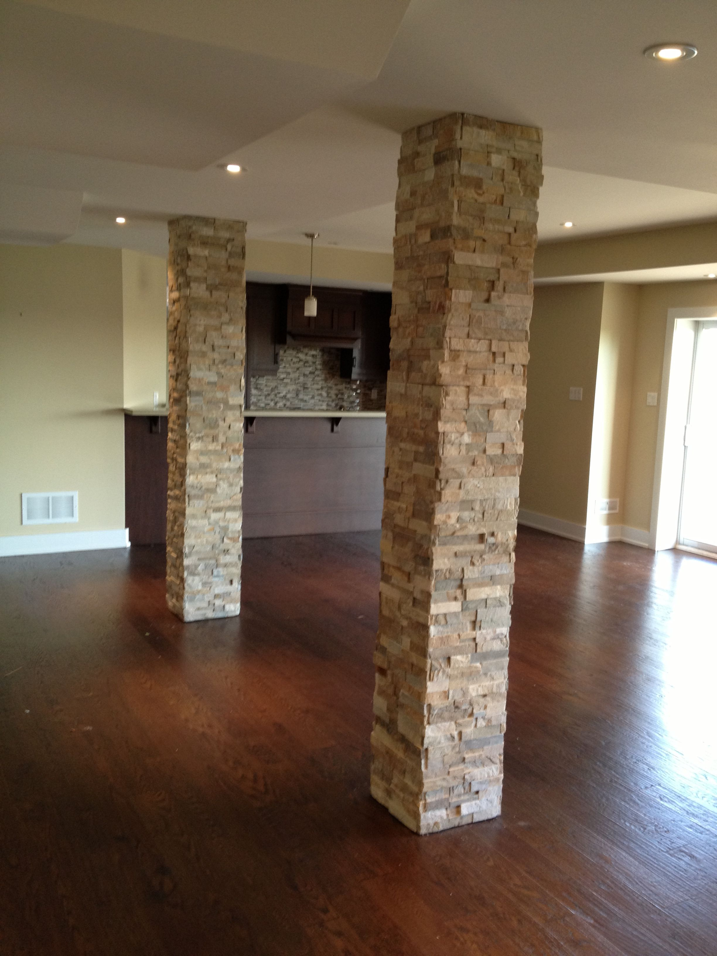 columns in basement  add stone they look fabulous  for the home . columns in basement  add stone they look fabulous