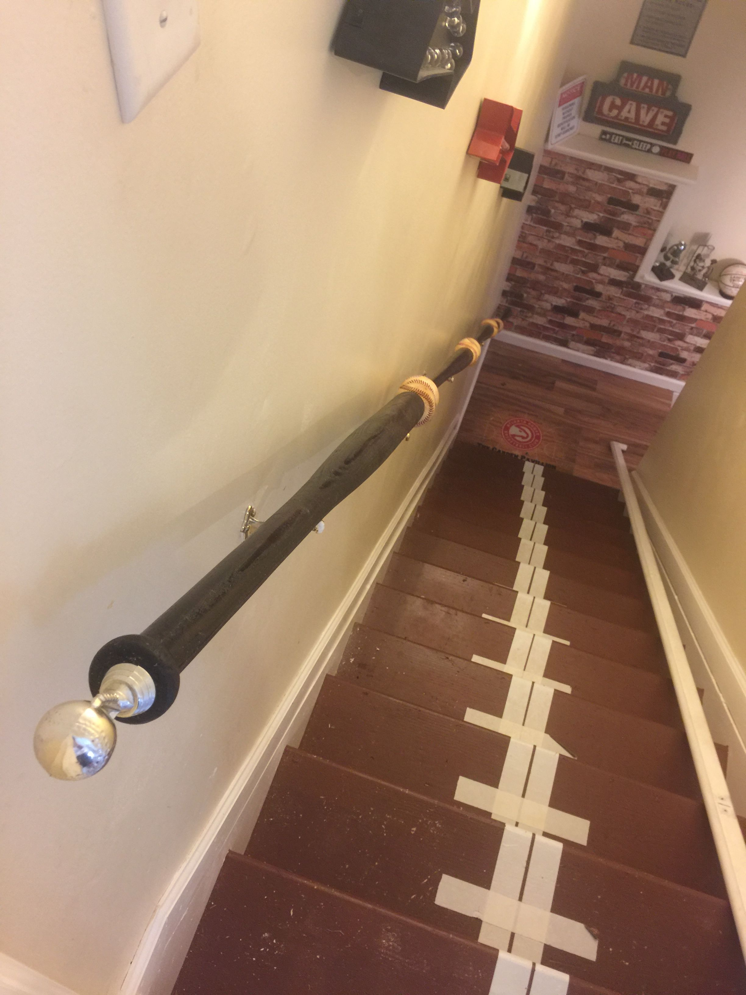 Baseball And Bats Handrail Leading Down To The Mancave