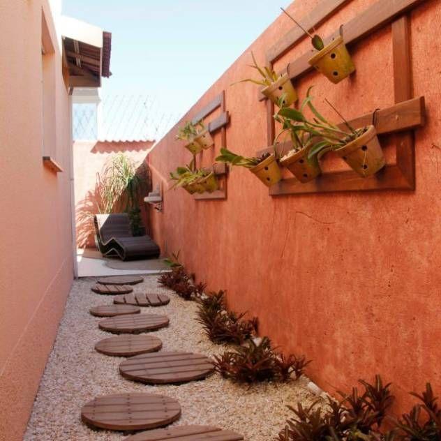 Residência em Jundiaí : Jardins de inverno rústicos por Carol Abumrad Arquitetura e Interiores