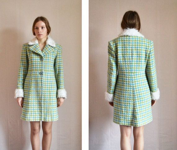 This vintage coat comes from 80s, although it perfectly resembles 60s mod trends. It has faux fur collar and cuffs, two large buttons on the front.