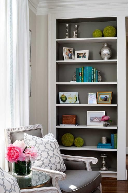 Chic Living Room Boasts A Reading Corner Filled With A