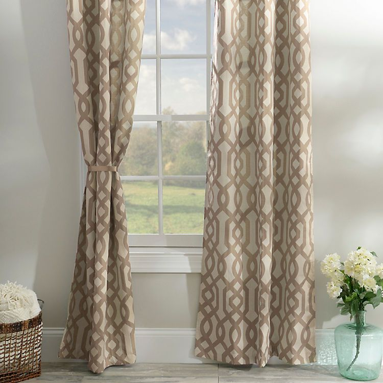 An interesting geometric pattern adorns the taupe gatehill curtain panels coupled with bronze grommets this panel set is a gorgeous curtain choice