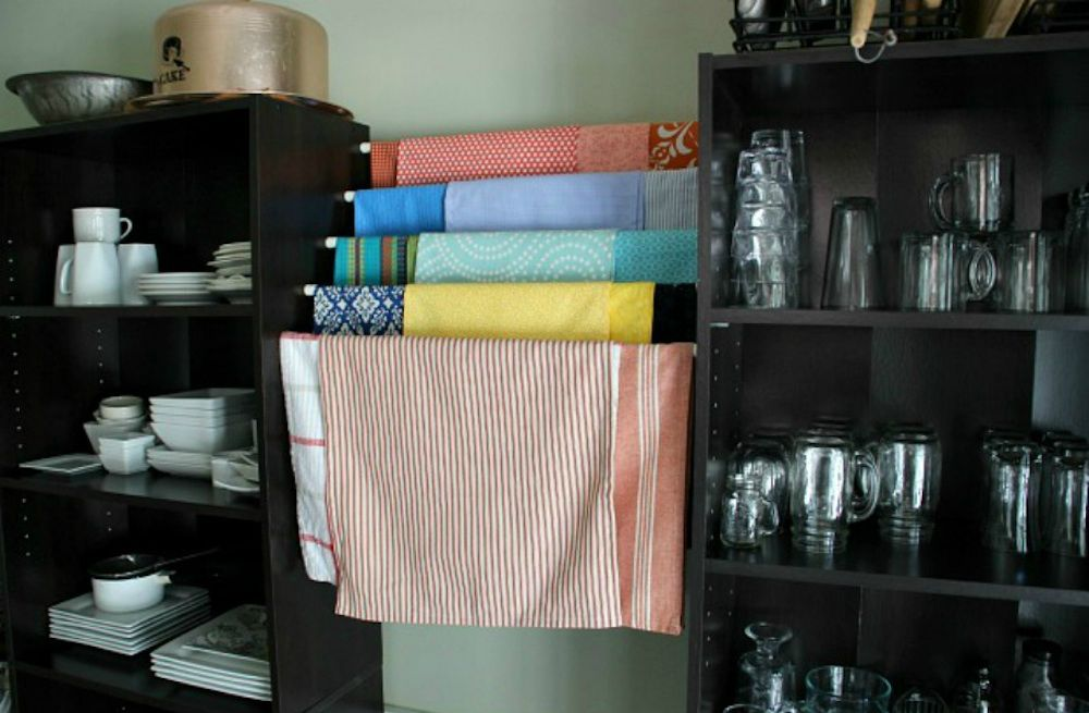 Free up some shelf and drawer space by using tensions rods for your kitchen hand towels. Get the tutorial here. Courtesy of Hometalker / Hoosier Homemade  - Redbook.com