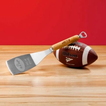 Whether grilling or just opening your favorite brew on game day, with your Sportula in-hand you have everything you need! Your favorite football team's name is heat-stamped onto the hard maple wood handle and team logo is laser etched onto spatula surface. This heavy-duty, stainless steel spatula features a bottle opener on its end. Hand wash only. *Officially licensed by the NFL. #NFL #spatula #dad #gift #heartdeeds