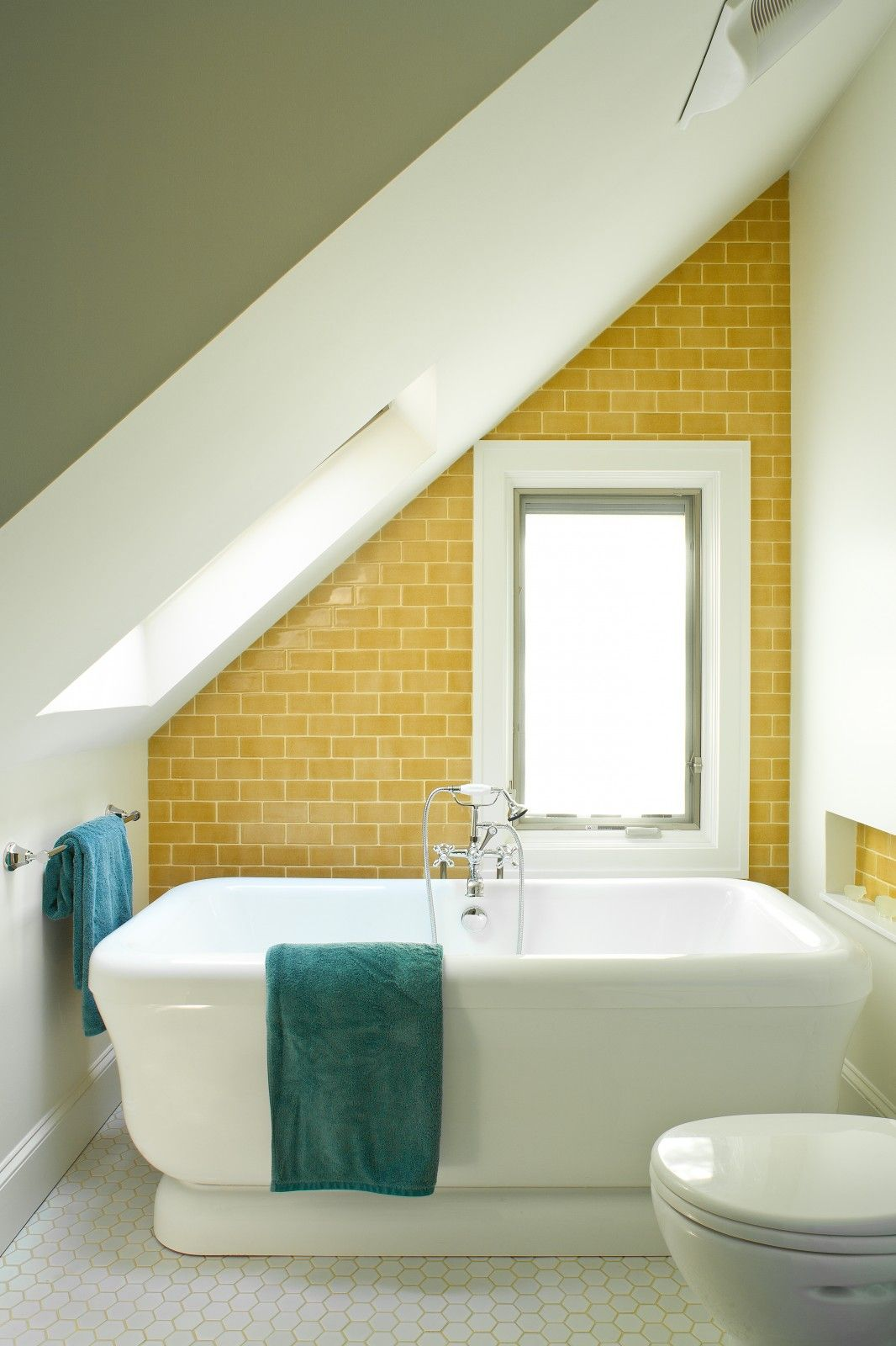 Love the subway tile + matching grout color of the floor tile ...