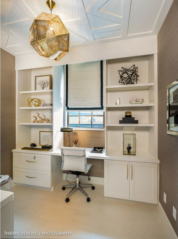 An eclectic assortment of accessories gives a stylish touch to this office completed by Alicia Kingsley Design. #luxeFL