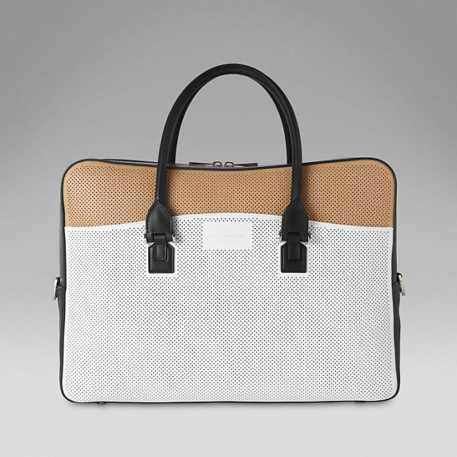 Eliot document case in perforated biscuit, white and black calf leather.   http://www.smythson.com/white-eliot-document-case.html