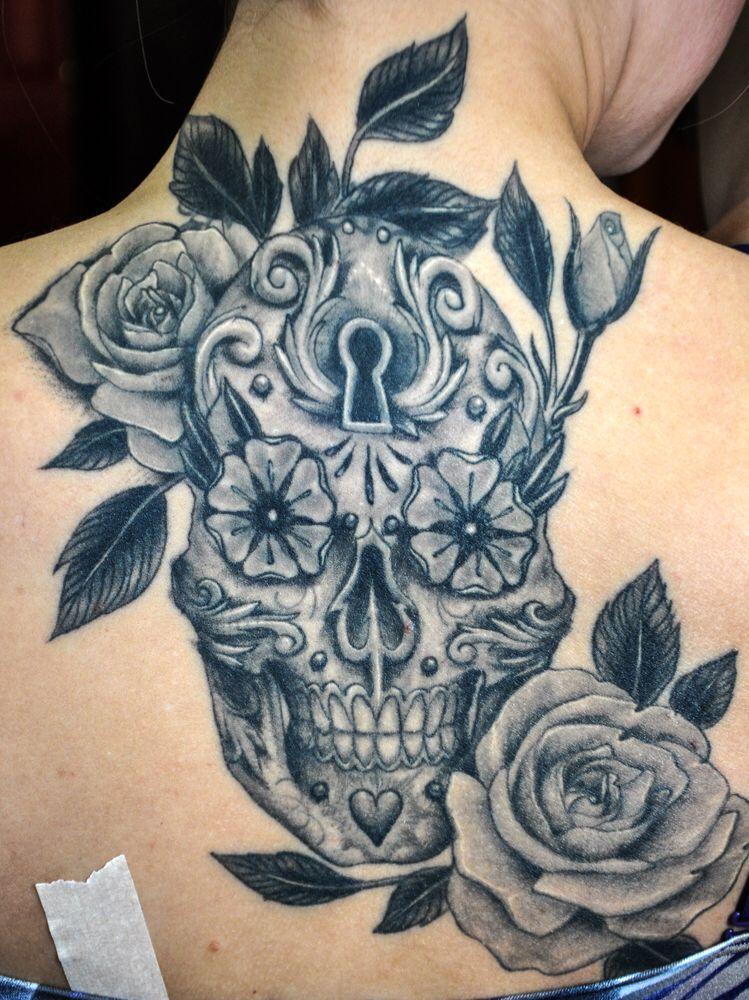 Image from http://www.tattoobite.com/wp-content/uploads/2013/11/dia-de-los-muertos-sugar-skull-tattoo-on-neck-back.jpg.