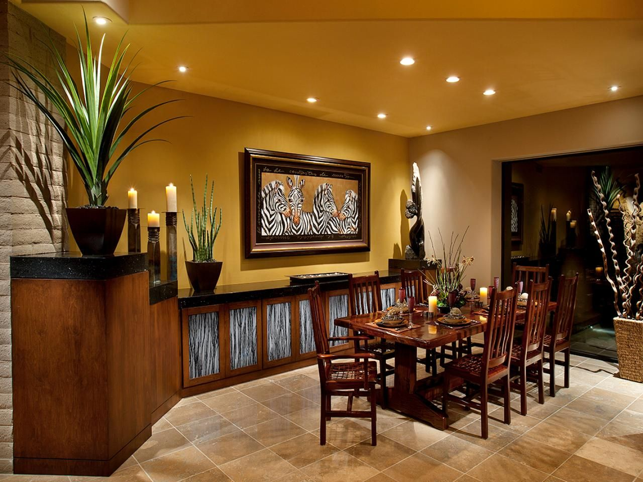 Yellow Transitional Dining Room With African Accents Tropical Dining Room African Living Rooms Dining Room Design African decor dining room