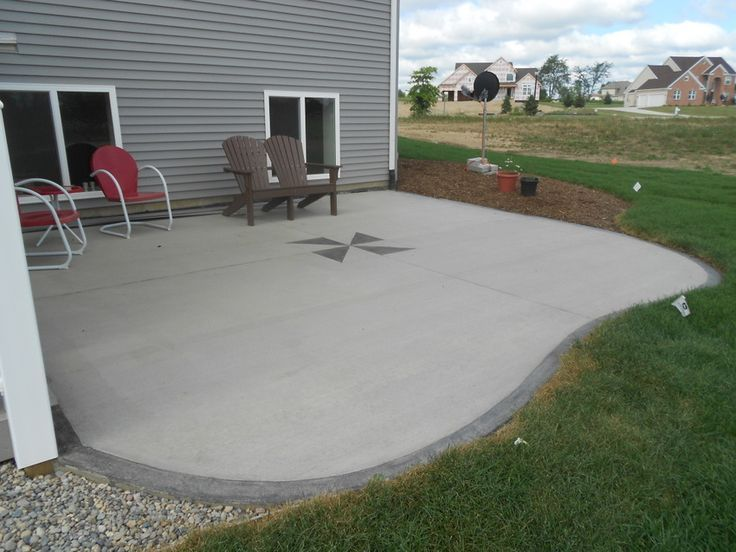 simple concrete patio ideas with red chair and brown chair ... on Simple Concrete Patio Designs id=63536