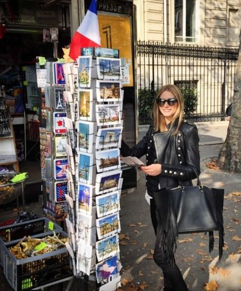 Olivia Palermo picking out postcards in Paris