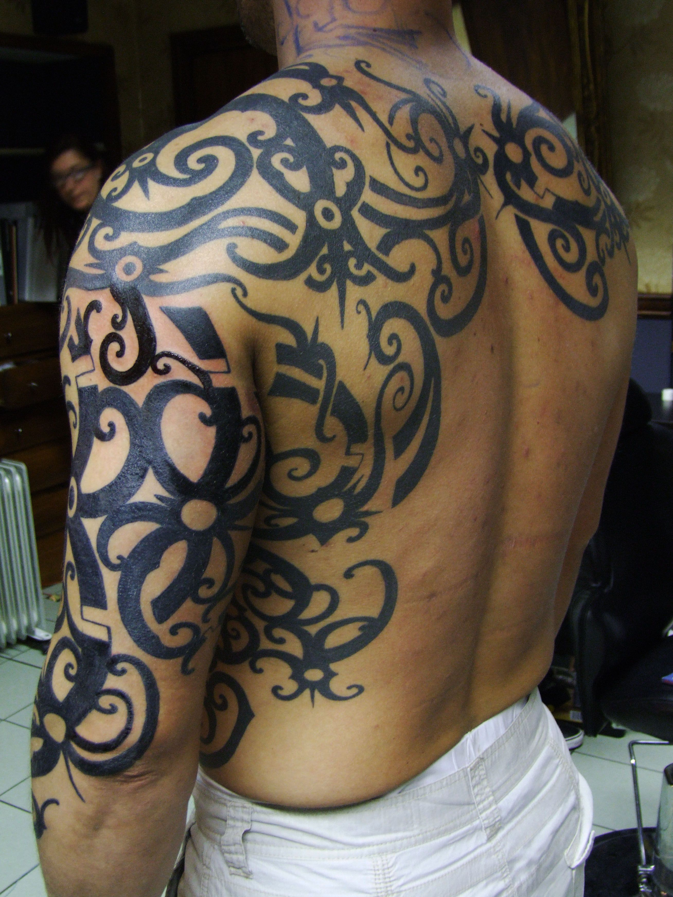 Mysterious Tribal Tattoos On Media Democracy Tribal Tattoos Tattoos Tribal Tattoos For Men
