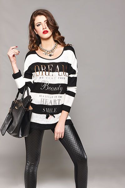 This winter time is all about soft, sweaters and leatherette leggings! Go for it...