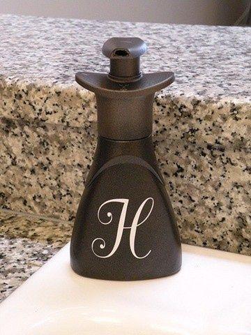 GENIUS! Originally a plastic, Dawn handsoap bottle. Bronze spray paint and a monogram sticker=expensive look.