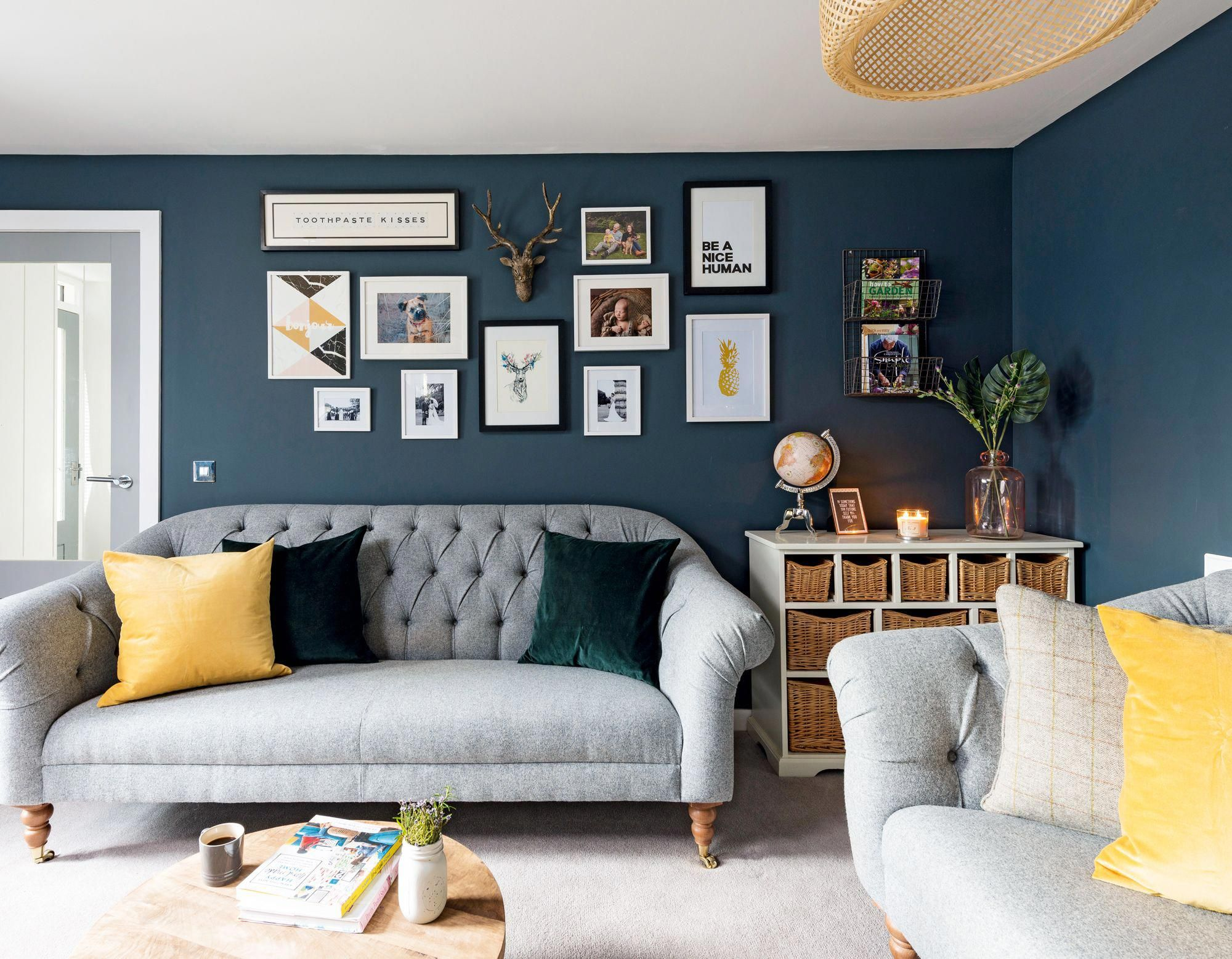 a dark navy living room with yellow accents and a grey