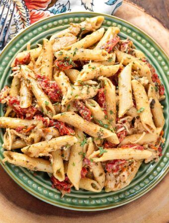 Instant Pot Pesto Pasta is a simple recipe that you can make with pantry staples. This pressure cooker pesto pasta recipe has a nice amount of flavor. Best of all, it is an Instant Pot dump and start recipe! simplyhappyfoodie.com #instantpot #pressurecooker #pasta #easydinner
