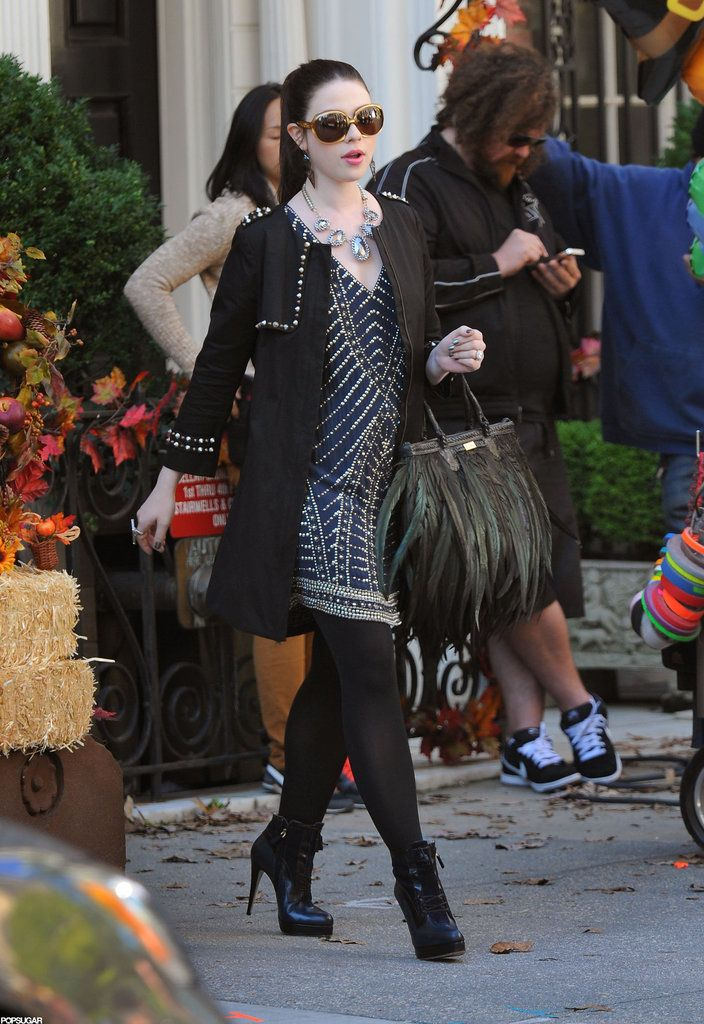 Georgina Sparks: Georgina struts around in a black embellished coat, blue beaded tunic dress, two-tone Jason Wu ankle boots ($1,195), and a lust-worthy feathered Angel Jackson bag.