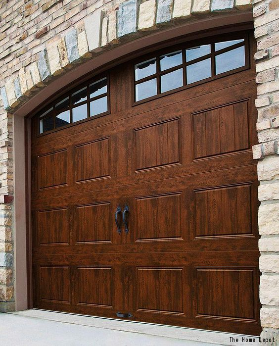 A Gorgeous Wood Garage With Decorative Windows And A Stone Siding Surround Click To See The Average Brick Exterior House Garage Door Design Garage Door Styles