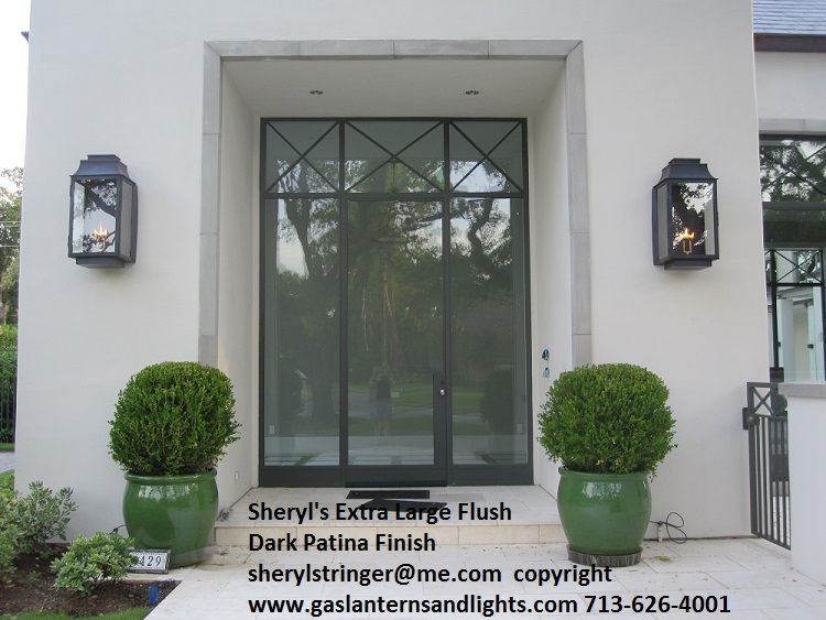 Contemporary Extra Large Flush Mount Gas Lanterns By Sheryl - Brick column lit by flush mounted core drilled well light