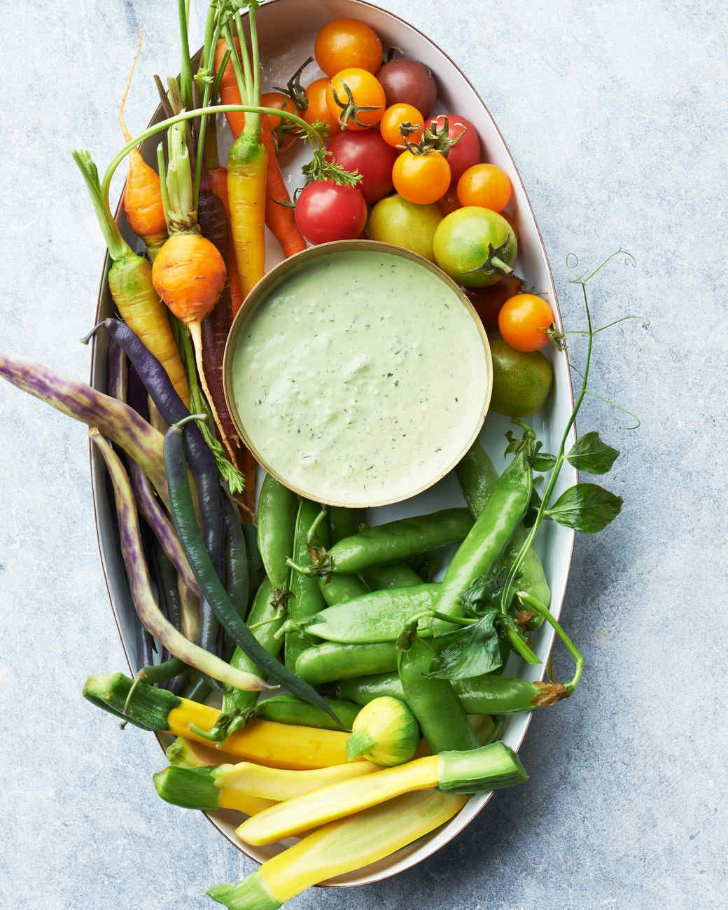 Green Goddess Dressing - doubles as a dip for a summertime crudite platter. The creamy concoction is studded with chopped fresh herbs and scallions, and it pairs particularly well with baby carrots and yellow squash, tender peas and beans, and little tomatoes.