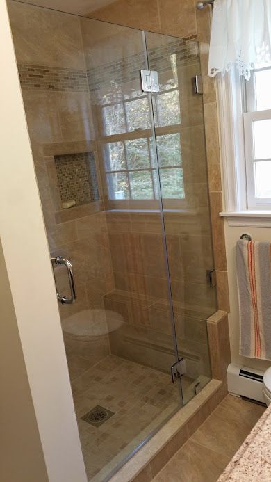 Frameless shower door hinged from the supporting panel which we ...