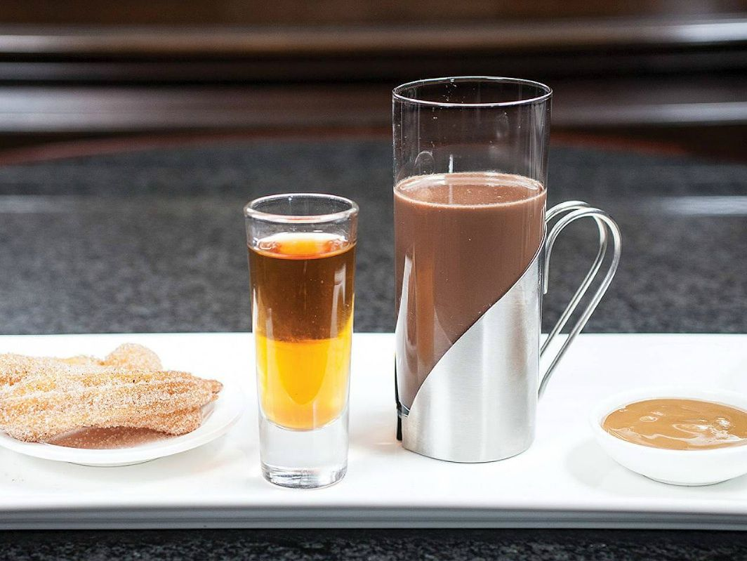 We're warming up with Mexican hot chocolate from @Four Seasons Hotel Chicago, served with  tequila, churros & dulce de leche. #FSTaste