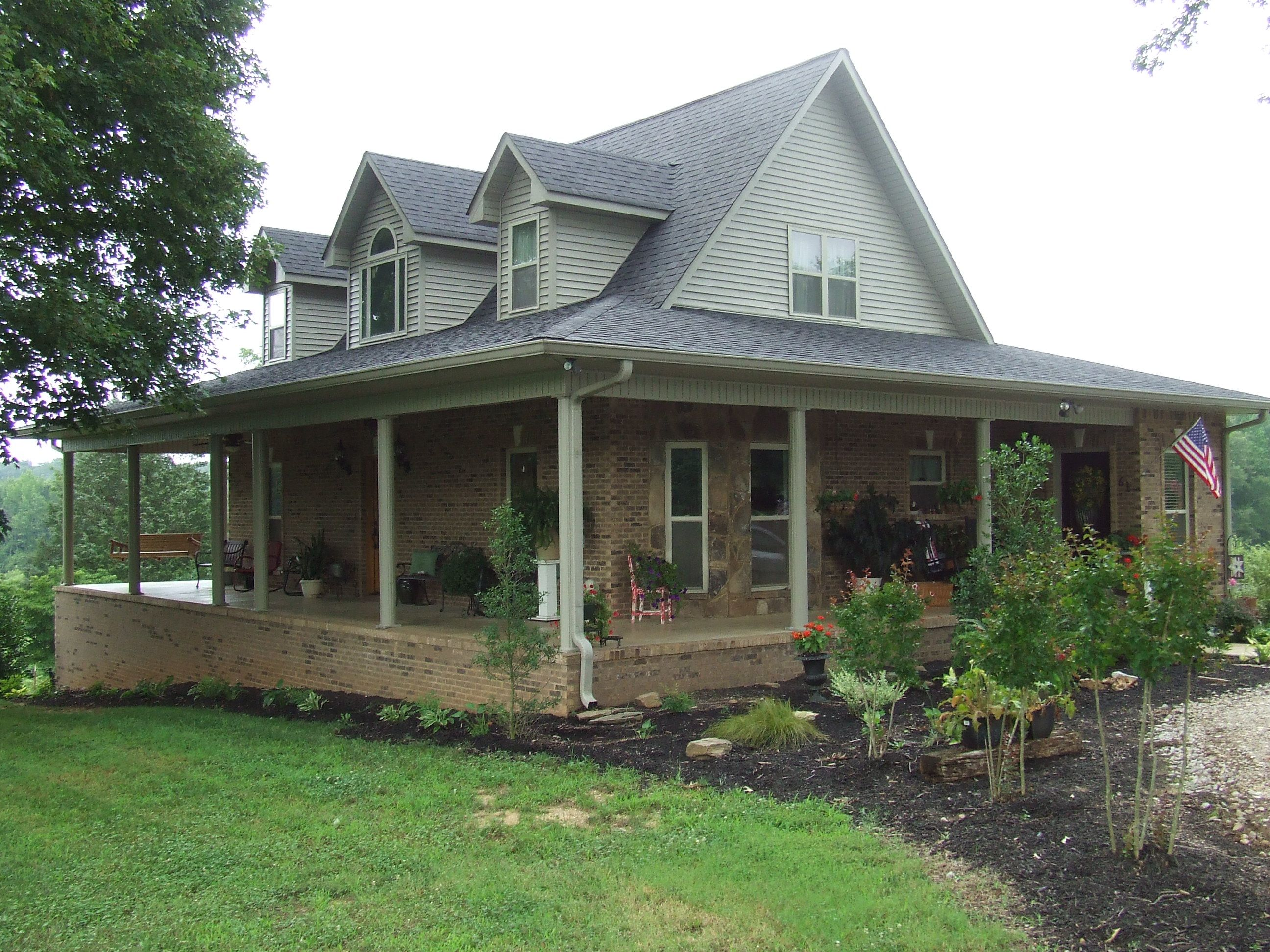 Brick house with wrap around porch siding on upper - Home designs with wrap around porch ...