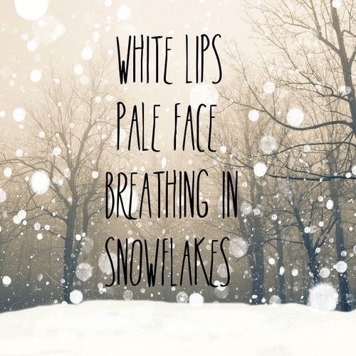 White lips, pale face, breathing in snowflakes