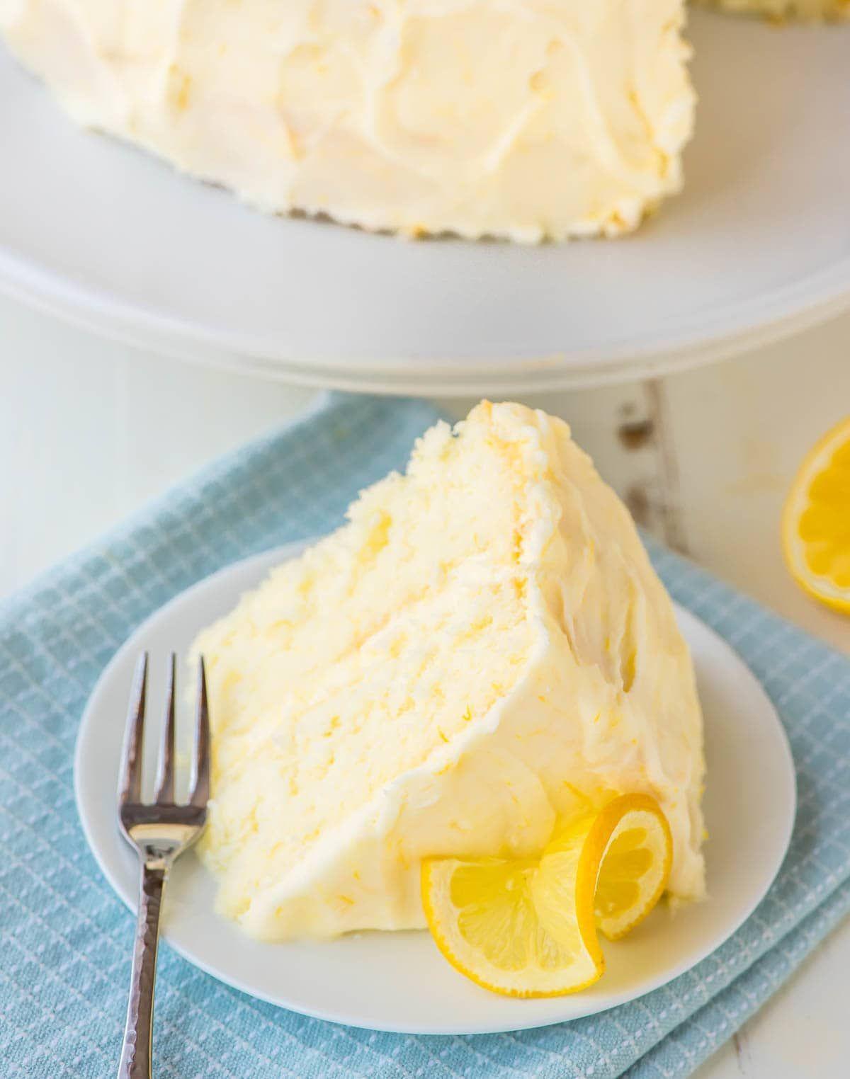 This Lemon Cake Recipe tastes like sunshine on a plate! Moist, fluffy and bursting with bright lemon flavor. Slathered in Lemon Cream Cheese Frosting and so dang good! @wellplated Lemon Cake Recipe tastes like sunshine on a plate! Moist, fluffy and bursting with bright lemon flavor. Slathered in Lemon Cream Cheese Frosting and so dang good! @wellplated