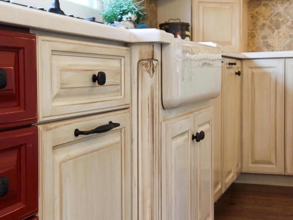 The assortment of colors within this kitchen create a warm and ...