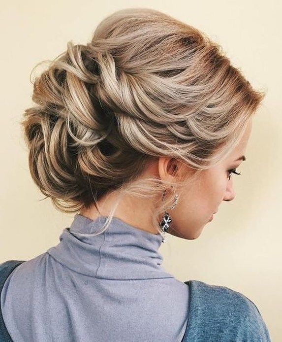 Pretty swept back hairstyle to try