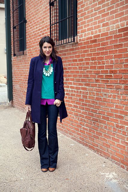 tall brown boots + skinny jeans + violet blouse + aqua sweater + indigo coat + statement necklace