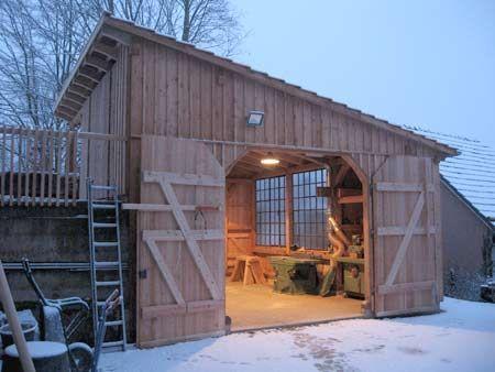 Fachwerk garage und holzwerkstatt mit scheunentoren for Haus bauen architekt