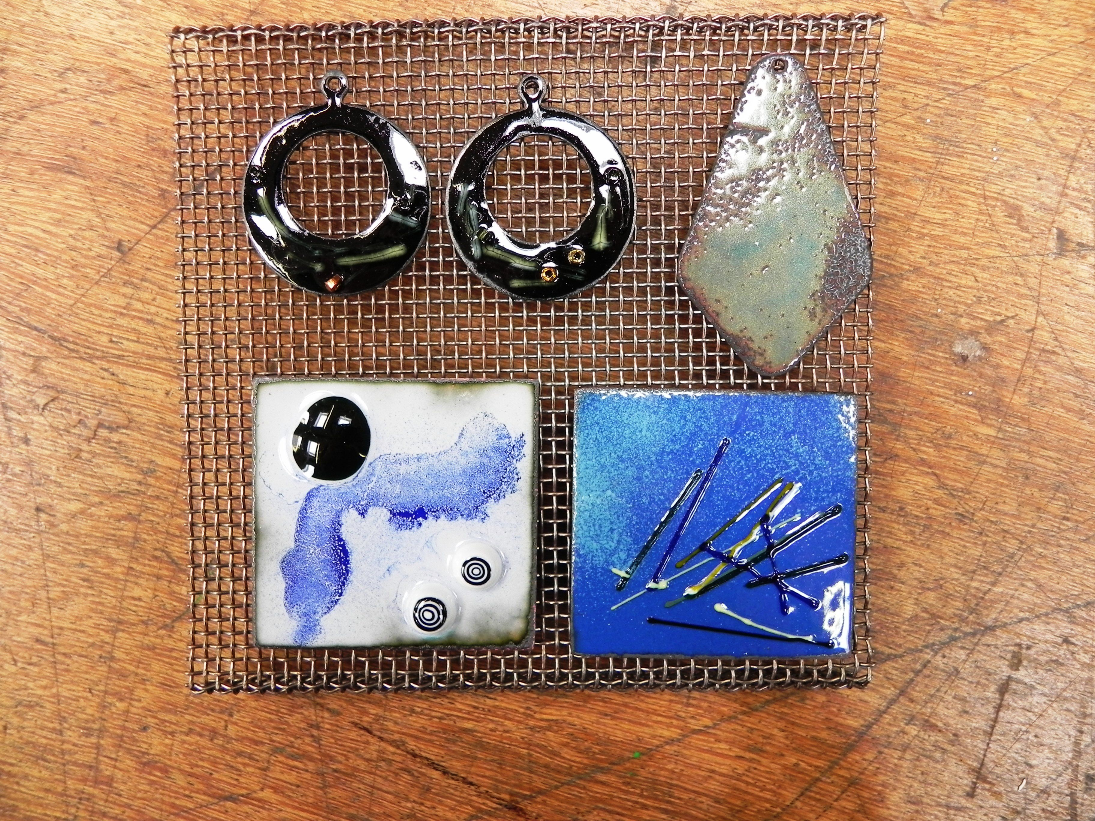 A variety of techniques and shapes for enamelling.