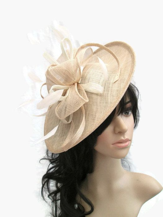 Nude shaped fascinator with ivory trim   feathers..on a headband 7560ed014ee6