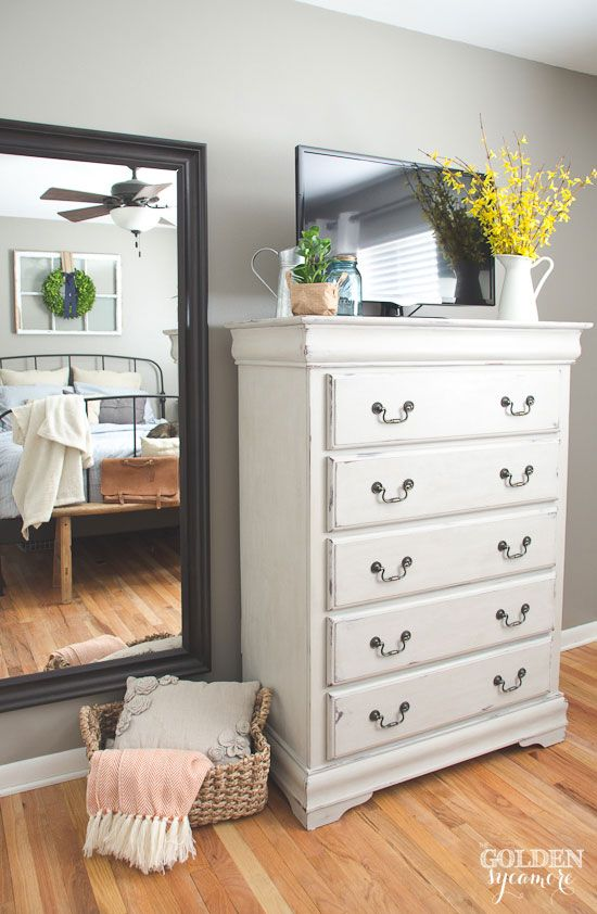 white bedroom dressers. I love the tall white dresser  with flowers as accent against grey walls Maison Blanche painted in Cobblestone Chalk White Lime Wax Cottage Bedroom DIY furniture makeover