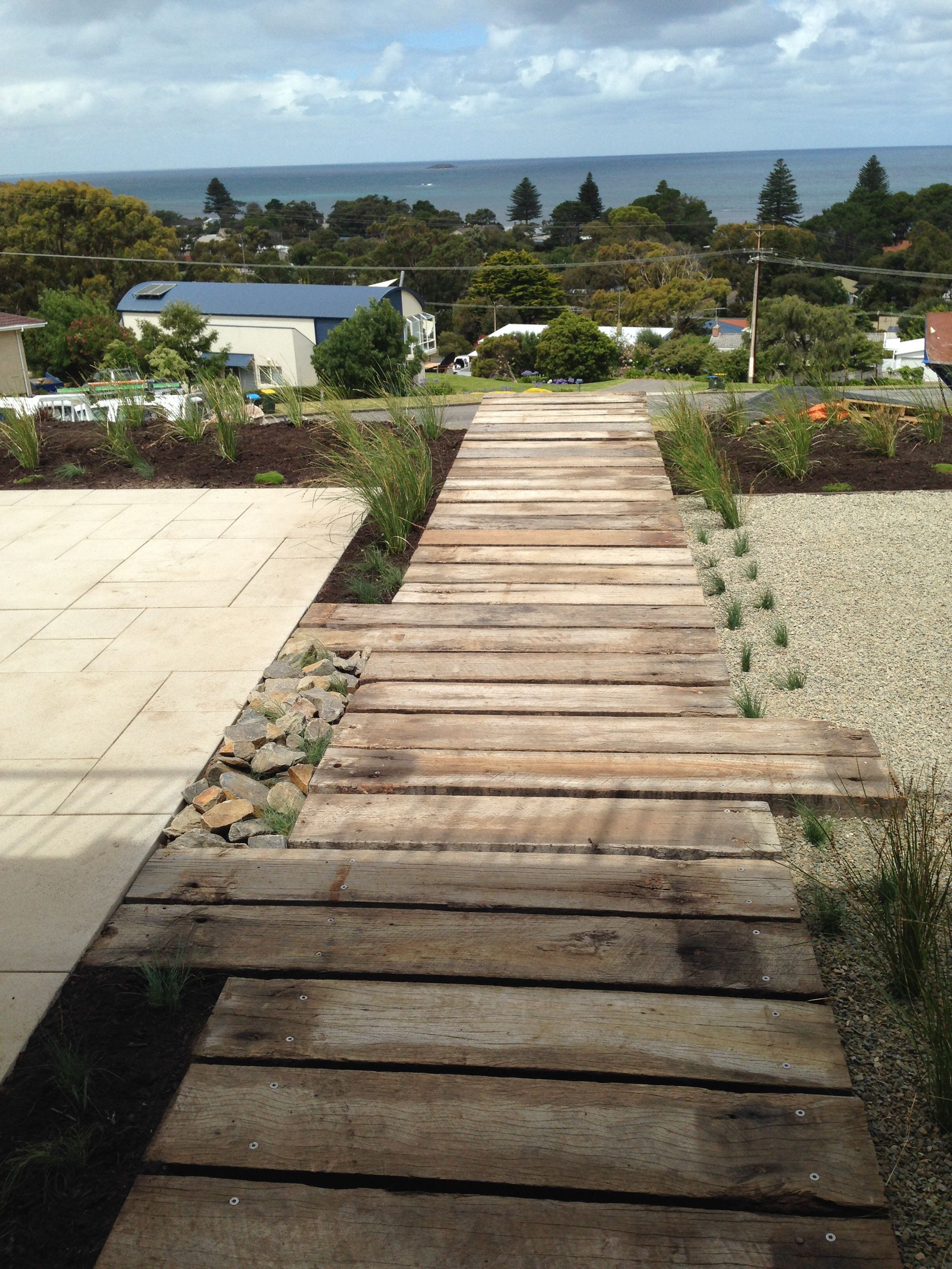 Recycled jetty timbers creating a feature in this adelaide for Paving and landscaping adelaide