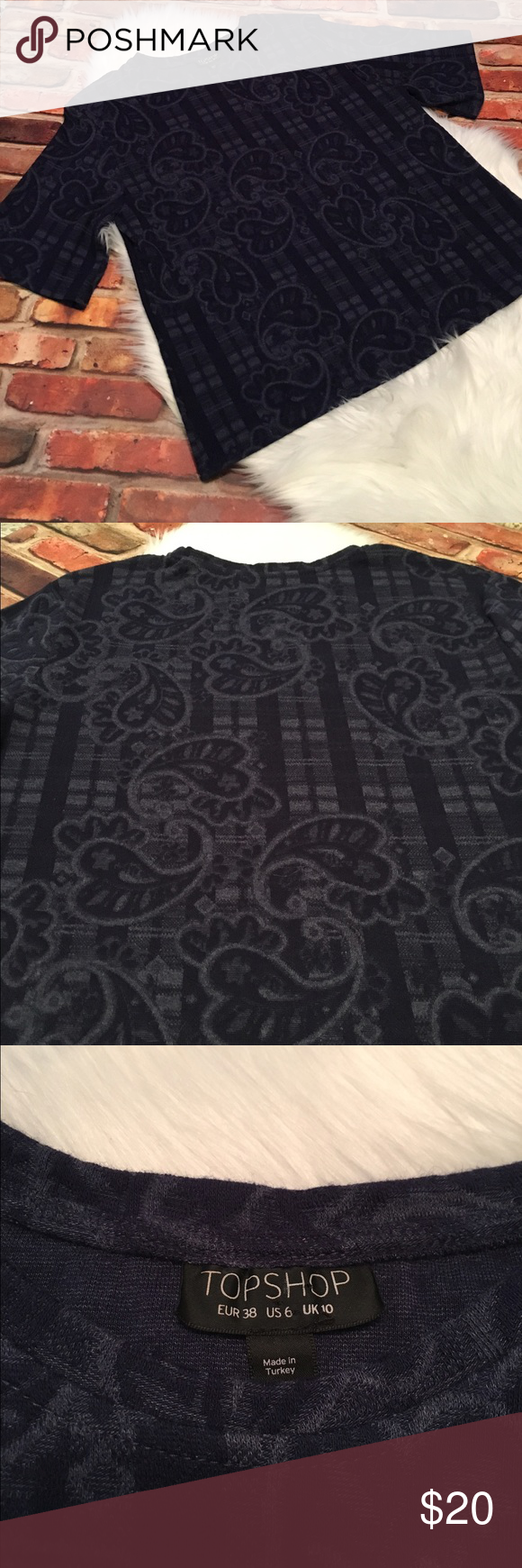 Topshop Paisley Boxy Half Sleeve Tee Size 6 Preowned Topshop Paisley Boxy Half Sleeve Tee/Top.  Size 6.  Beautiful Tee.  This has been preloved and is in overall excellent condition.  Navy blue paisley jacquard pattern. See all pictures as you will receive as pictured. No trades/no holds.  All offers (lowest ?'s) via make offer button only please (reasonable offers). Thanks for looking and Happy Poshing! Topshop Tops