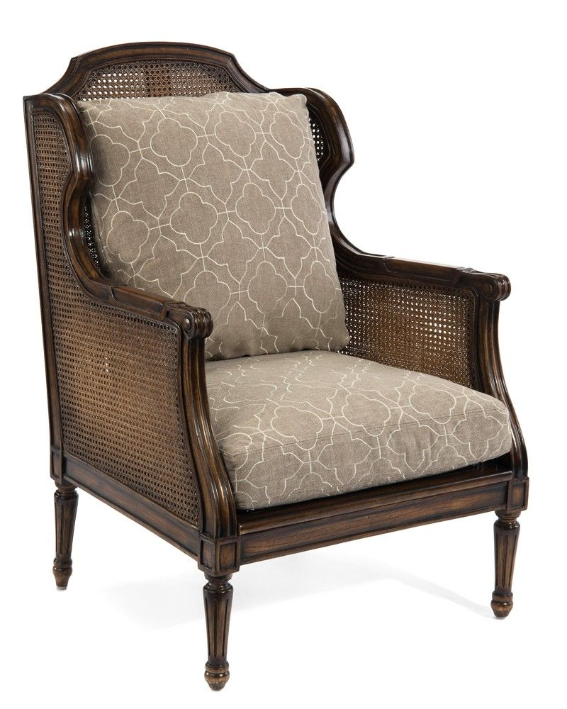 Cane wing chair with loose cushions upholstered exposed