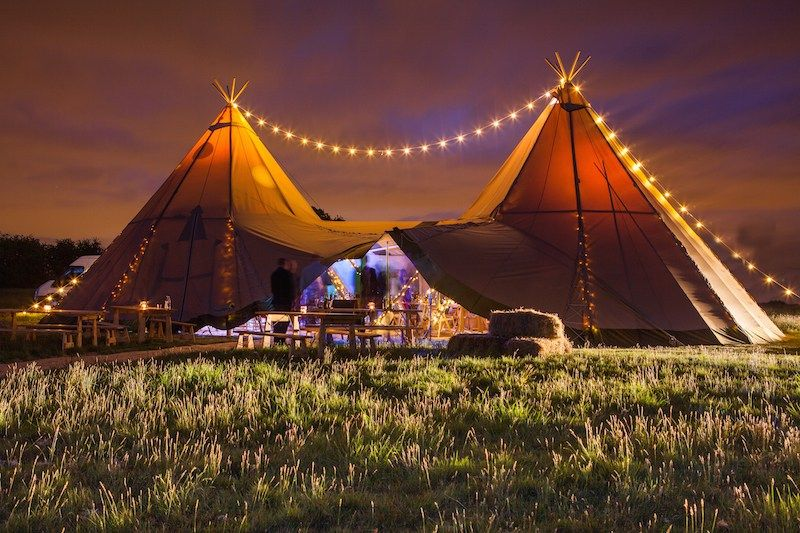 Festoon lighting over two giant hat tipis by sami tipi  Image by Christopher…