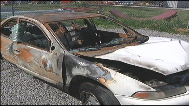 Police in Spring Hill are continuing to search for the person who recently set a car on fire after firing two shots into the vehicle and scratching a curse word into the trunk.