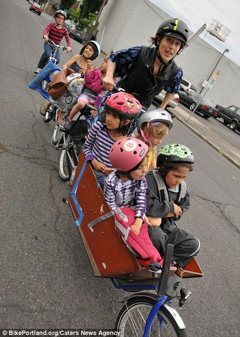 Wow Super Mom Modified a bicycle to carry all SIX of her children to Run School