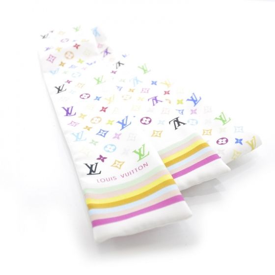 This is an authentic LOUIS VUITTON Silk Multicolor Bandeau in White.   This stylish bandeau style scarf is 100 silk and features a Multicolore Louis Vuitton monogram in 33 vivid colors on white.