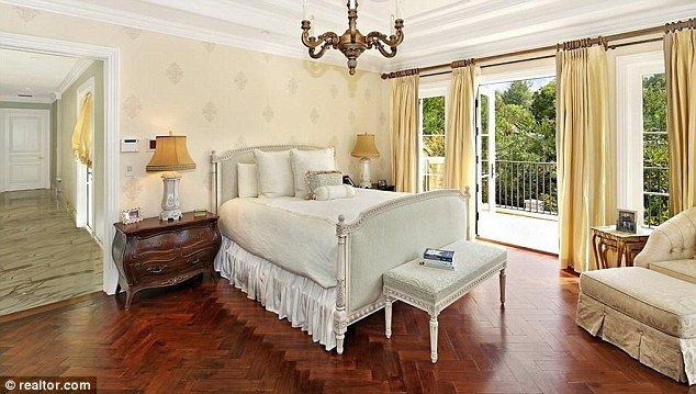 Parents' retreat: The master bedroom has French doors opening onto a private balcony...