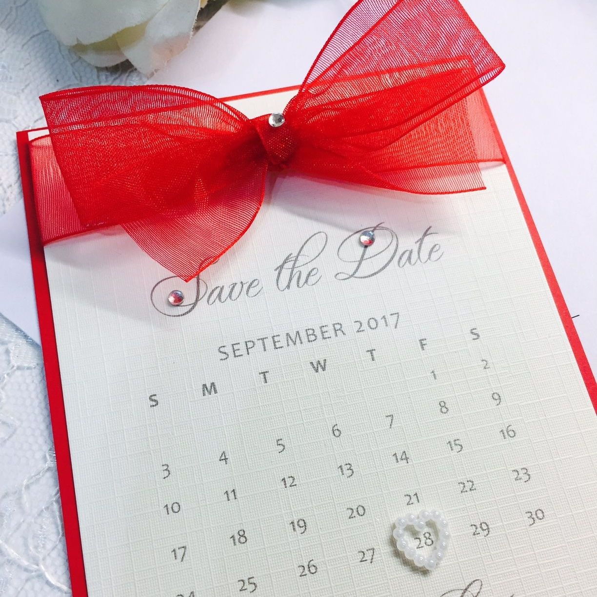 Save the date calendar cards with red organza ribbon and pearl heart ...