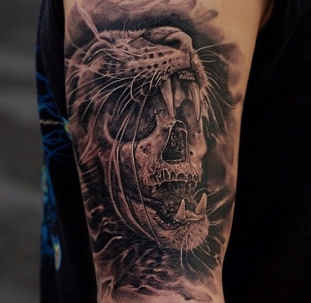 Skull lion's head tattoo
