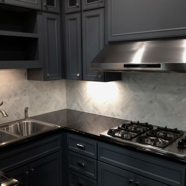 White Cabinets Gray Subway Tile Kashmir White Granite: ... -blue Cabinets, Dark Counter Tops, And Marble Herringbone