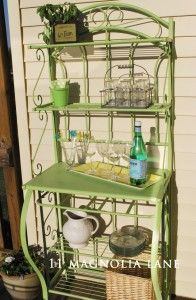 A Bakers Rack Spray Painted Green And Used As An Entertaining On The Patio