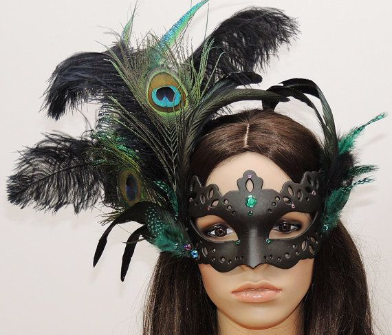 +++ Peacock feather mask +++  Color design: Black - Green  The interesting perforated mask is set with sparkling Strassteinen by Swarovski. An asymmetric jewelry made of elegantly swinging ostrich feathers, Rooster feathers and mysterious four spot adorn the Venetian mask.  I made these exceptional pieces of jewelry in the Studio for Mask magic & experience art in Berlin. Who may visit me there is welcome. Please an appointment with me.  Marén Söhnlein m@skenzauber.de www.maskenzauber.com