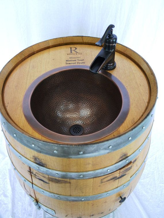 I just love this sink made from an old wine barrel